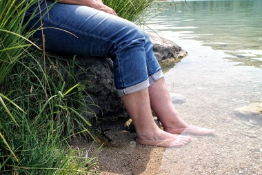 person-feet-in-lake-nature